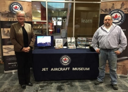 GCC member Marti Acton works the Jet Aircraft Museum display with JAM Marketing Director, Mike Kestle.