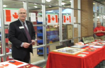 GCC 1st VP Gerry Treble works the GCC table with GCC Past President Randy Warden at the Legion table.